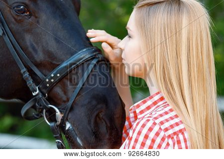 Smiling girl palming the horse