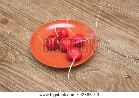 Radishes On A Wooden Background