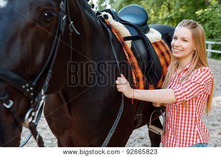 Girl standing near the horse