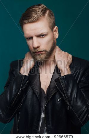 Portrait of young beautiful fashionable man with leather jacket