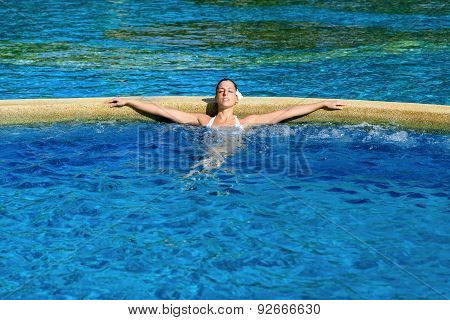 Woman Relaxing And Resting In Spa Pool At Resort