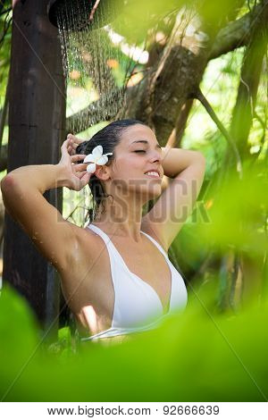 Woman Relaxing In Spa Outdoor Shower