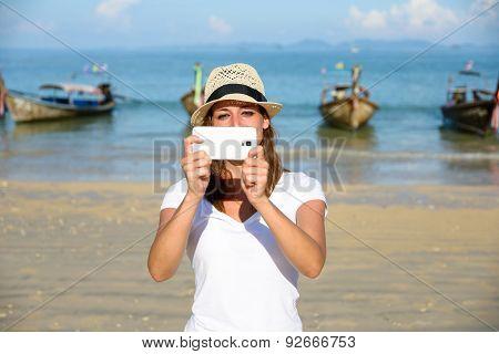 Tourist On Thailand Travel Taking Photos With Smartphone At Krabi Beach