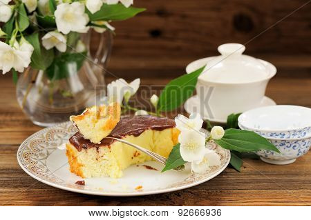 Homemade Baked Pudding With Chololate Icing, Jasmine Flowers And Chinese Teaware