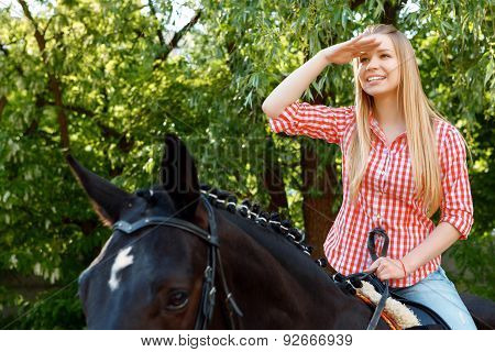 Girl looking ahead on the horse