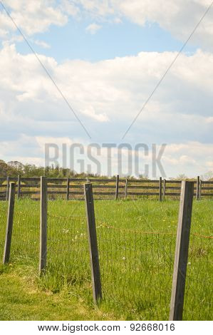 Country Fence, Green Grass, and Blue Skies.