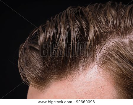 Hairstyle On Male Person With Brown Hair At Closeup Isolated Towards Black Background