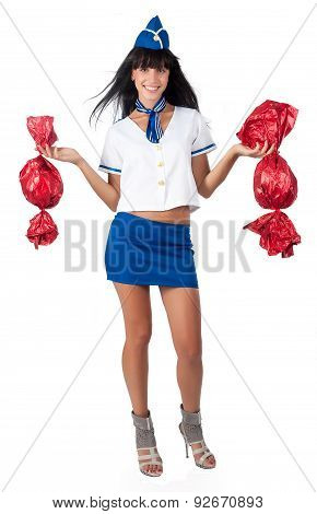 Young beautiful air hostess with 2 big candies