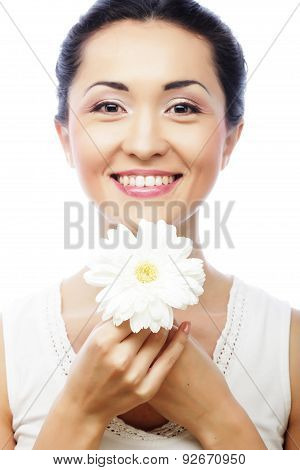 young asian woman holding white gerber flower