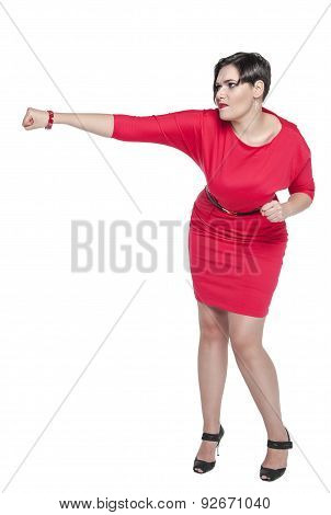 Beautiful Plus Size Woman In Red Dress Beating Something Isolated
