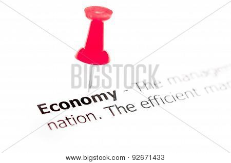 Word Economy Pinned On White Paper With Red Pushpin