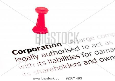 Word Corporation Pinned On White Paper With Red Pushpin