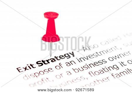 Word Exit Strategy Pinned On White Paper With Red Pushpin