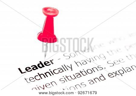Word Leader Pinned On White Paper With Red Pushpin