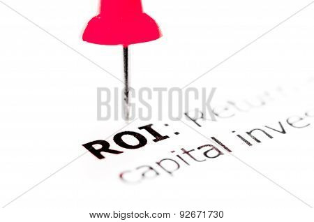 Word Roi Pinned On White Paper With Red Pushpin