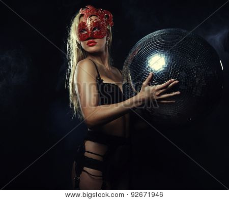 lady in mask with disco ball