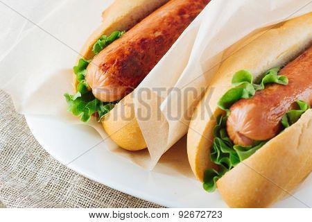 Hotdogs On Wooden Table