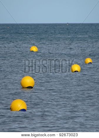 Buoys Floating Upon Ocean Seascape