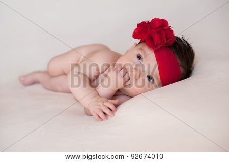 Baby Girl With A Large, Red, Flower Headband