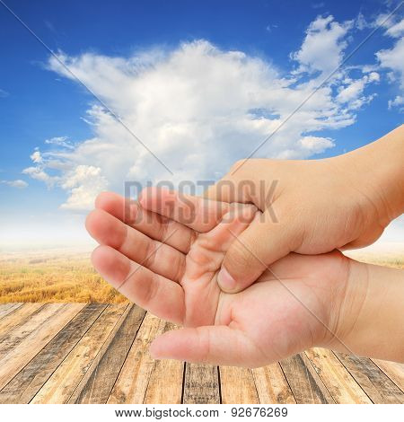 Hand Pain On Wooden Table And Blue Sky Background
