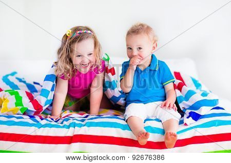 Children Sleeping Under Colorful Blanket