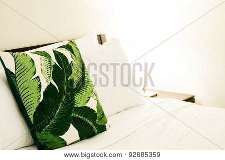 Tropical Throw Pillow On Bed