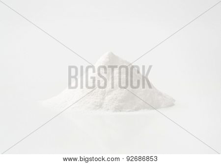 handful of cooking soda on white background