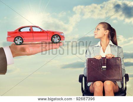 Businesswoman sitting in chair