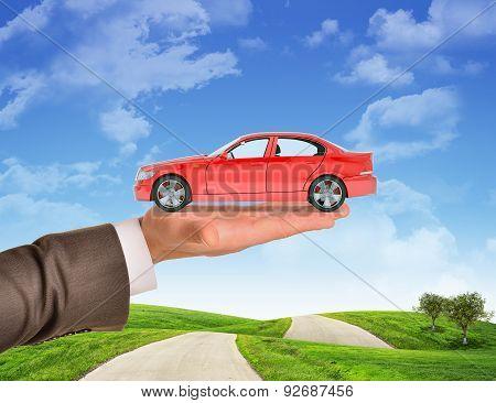 Car on businessmans hand