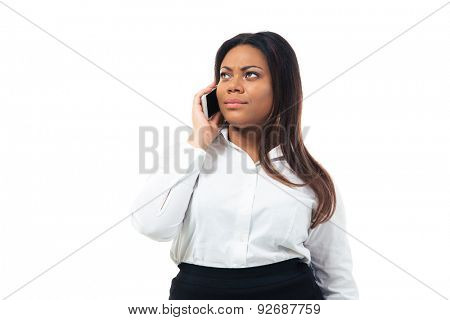 Pensive afro american businesswoman talking on the phone isolated on a white background. Looking up