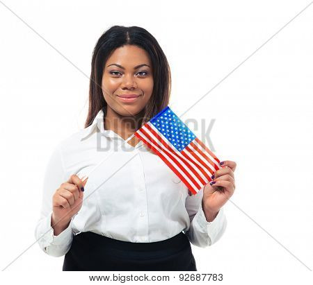 Smiling african businesswoman holding US flag isolated on a white background. Looking at camera