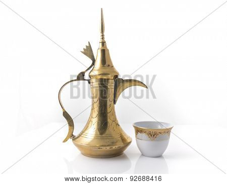 Traditional arabic coffee mug and coffee cup - stock image