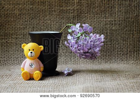 Still-life With A Lilac And A Toy Bear.