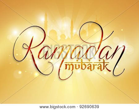 Beautiful golden greeting card design with stylish text Ramadan Mubarak in front of shiny mosque for Islamic holy month of prayers, celebration.