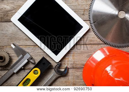 Tools And Tablet On A Wooden Table