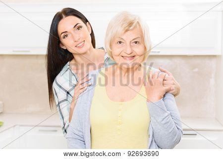 Granddaughter standing behind her granny