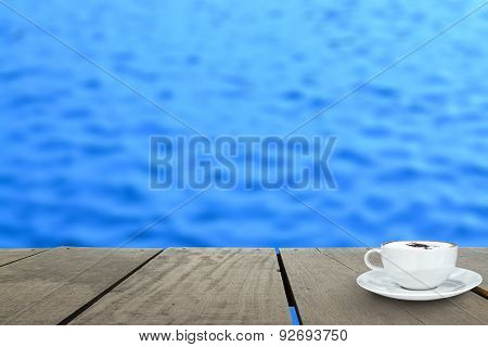 Veranda Wood And Coffee Inside River (blur Background)