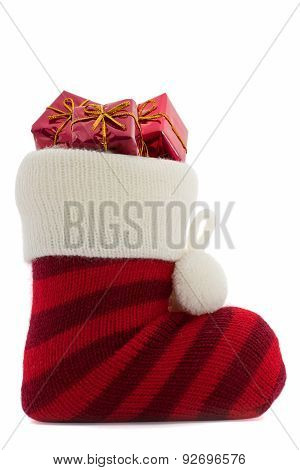 Christmas stockings with presents over white background