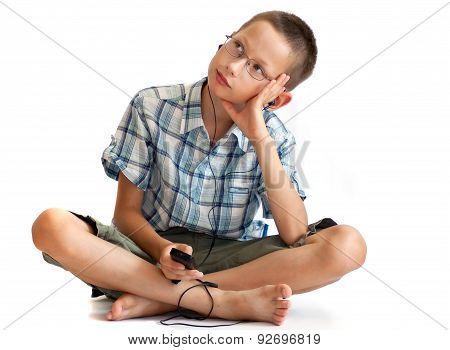 Boy listening music over white