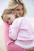 pic of cuddle  - Mother Cuddling Young Daughter outdoors - JPG