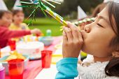 image of blowers  - Girl With Blower At Outdoor Birthday Party - JPG