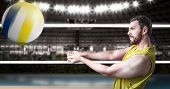 picture of volleyball  - Volleyball player on yellow uniform in volleyball court - JPG