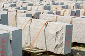 stock photo of slab  - Large slabs of granite secured by belts on pallets - JPG