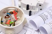 stock photo of electrical engineering  - Copper wire connections in electrical box rolls of electrical diagrams and electric fuse on construction drawing of house accessories for engineering work energy concept - JPG
