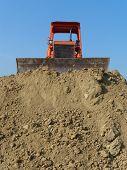 foto of grub  - old orange bulldozer stops waiting for work - JPG