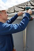 pic of gutter  - Workman Replacing Guttering On Exterior Of House - JPG