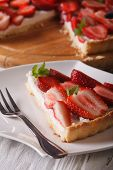 foto of tarts  - a piece of strawberry tart with cream cheese on a plate close - JPG