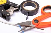 picture of electrical engineering  - Cable cutter electric wire and black insulating tape on white background accessories for engineer jobs and repair of electrical cable - JPG