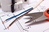 foto of wire cutter  - Cable cutter electric wire and fuse lying on construction drawing of house accessories for engineer jobs - JPG
