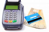image of terminator  - Payment terminal with credit card and money on white background credit card reader payment terminal with cash finance concept - JPG
